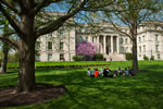 A class takes advantage of temperatures in the 70s and gathers outdoors near Schaeffer Hall.