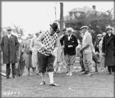 W.O. Finkbine tees off at the University's new golf course, October 1925.