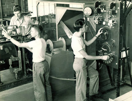 Adjusting levers and dials in the hydraulics laboratory, Aug. 15, 1948.