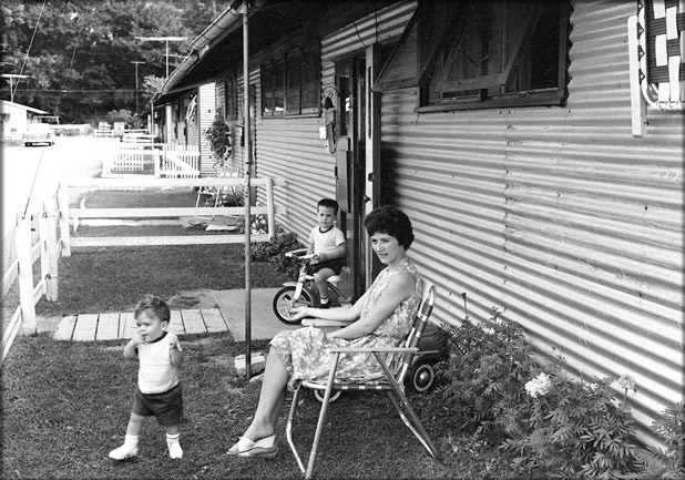Mother with children at Riverside Park unit, 1966