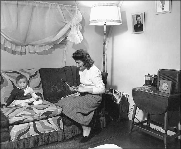 Mother with child in a temporary housing unit (location unknown), 1948