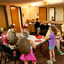 Osage Summer Theatre Program interns Amber Foster and Adam Phillips (center, in yellow shirts) assist the children in the greenroom as they prepare for the day's dress rehearsal.
