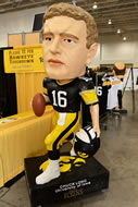 A featured guest at the FRY Fest trade show was a giant bobble head figure of former Hawkeye quarterback Chuck Long.