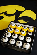 These black and gold Hawkeye billiard balls have numbers on the back.